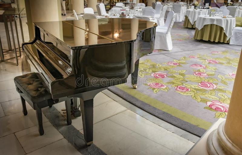 Grand piano inside a large dining room stock photo