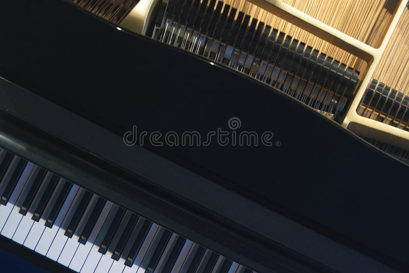 Grand piano instrument in a theater ready for a classical music concert. Top view for a flat lay overhead shot. With empty copy space for Editor`s text stock images