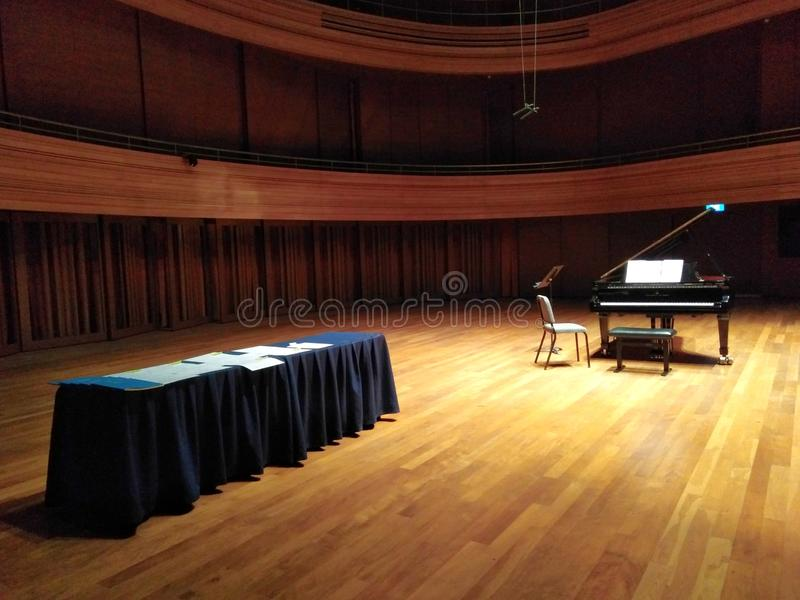 Grand piano on stage royalty free stock photography