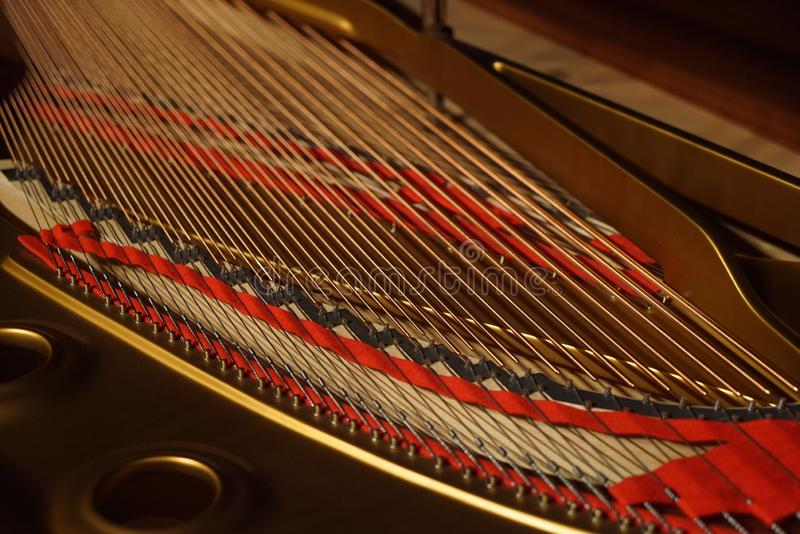 Grand piano strings, close-up. Musical instrument inside royalty free stock photo