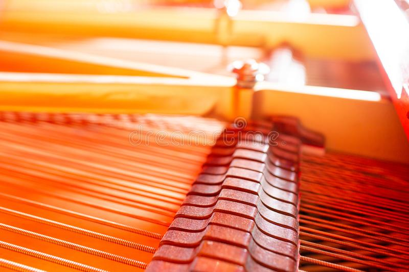 Grand piano strings, steel wire core wound with copper wire. Musical instrument abstract.  royalty free stock image