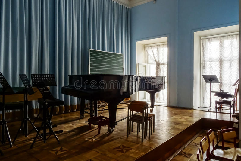 Grand piano waiting for children. In music school royalty free stock photo
