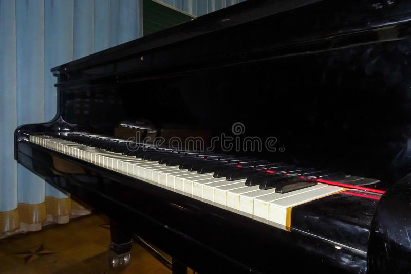 Grand piano waiting for children. In music school stock photography