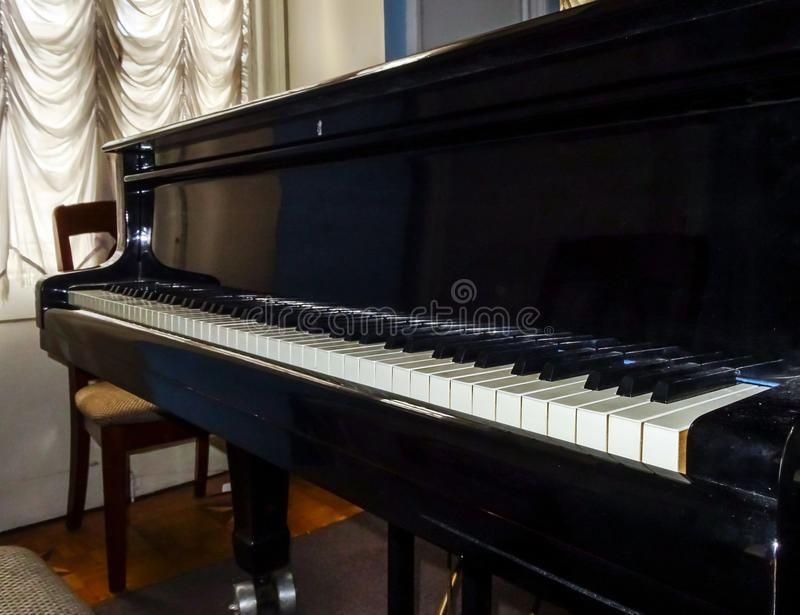 Grand piano waiting for children. In music school royalty free stock photos