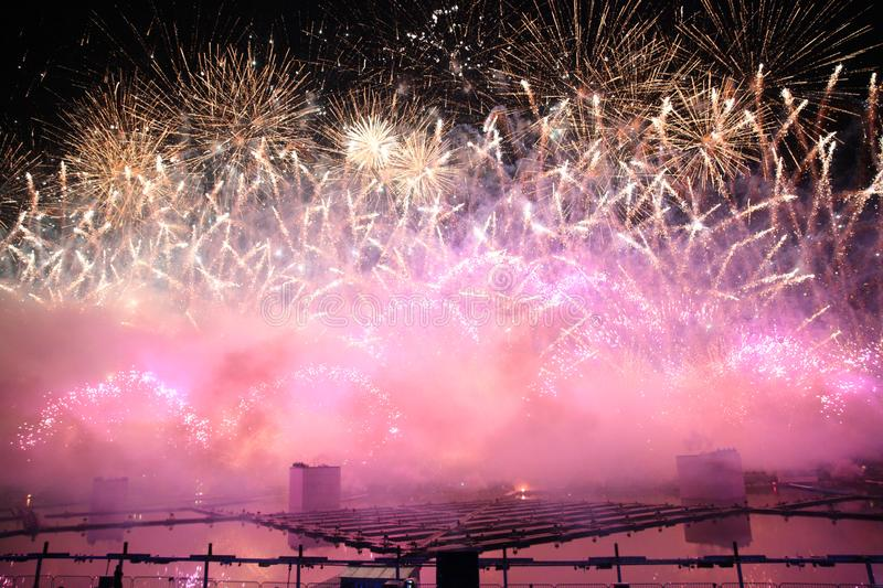 Grand pink Fireworks in the sky with sparks and colorful fog stock image