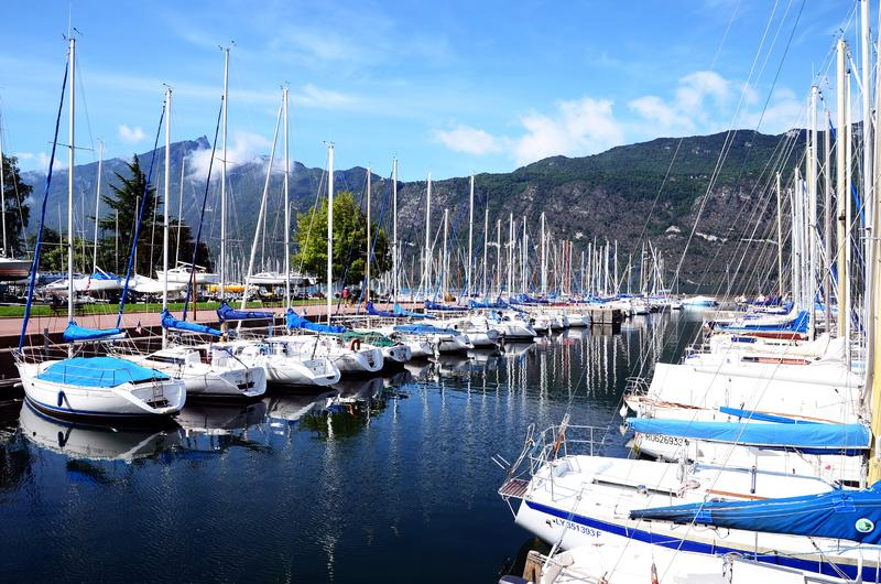 The Grand Port with its boats and lake Bourget view in the town of Aix les Bains in the. Aix-les-Bain, France - September 3, 2017: The Grand Port with its boats stock photos