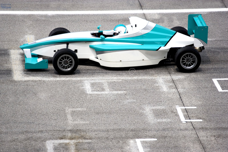 Grand Prix. Racing car at starting grid royalty free stock photography
