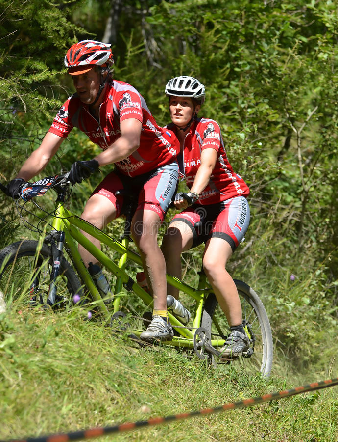 Grand Raid 2012. EVOLENE, SWITZERLAND - AUGUST 18: Tandem champions Patrick Tabourat in the world famous Grand Raid mountain bike race: August 18, 2012 in stock images