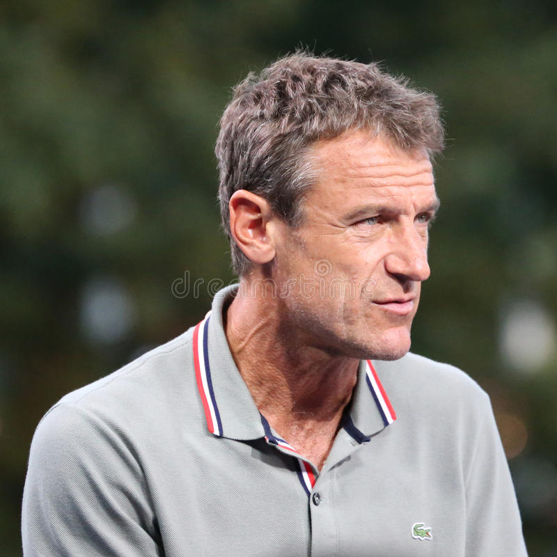 Grand slam champion and Eurosport analyst Mats Wilander comments match at US Open 2015. NEW YORK - SEPTEMBER 1, 2015: Grand slam champion and Eurosport analyst stock photography