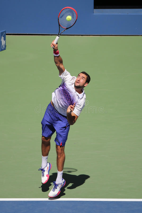 Grand Slam champion Marin Cilic of Croatia in action during his round 4 match at US Open 2015 at National Tennis Center. NEW YORK - SEPTEMBER 6, 2015: Grand Slam stock photos