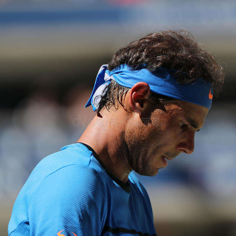 Grand Slam champion Rafael Nadal of Spain in action during his US Open 2016 first round match. NEW YORK - AUGUST 29, 2016: Grand Slam champion Rafael Nadal of royalty free stock photography