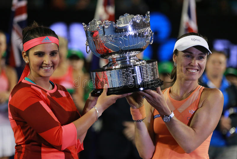 Grand Slam champion Sania Mirza of India and Martina Hingis of Switzerland during trophy presentation after doubles final match. MELBOURNE, AUSTRALIA - JANUARY stock image