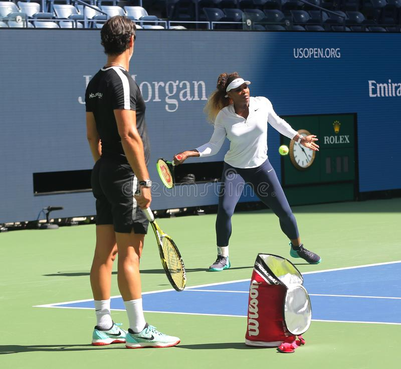 Grand Slam champion Serena Williams with her coach Patrick Mouratoglou during practice for the 2019 US Open stock images