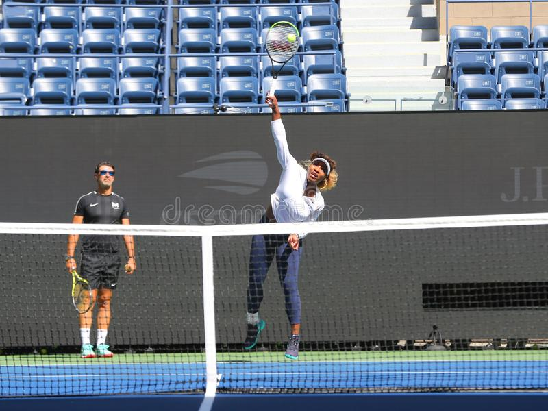 Grand Slam champion Serena Williams with her coach Patrick Mouratoglou during practice for the 2019 US Open royalty free stock image