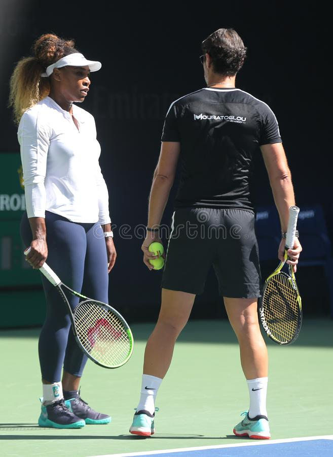 Grand Slam champion Serena Williams with her coach Patrick Mouratoglou during practice for the 2019 US Open stock image