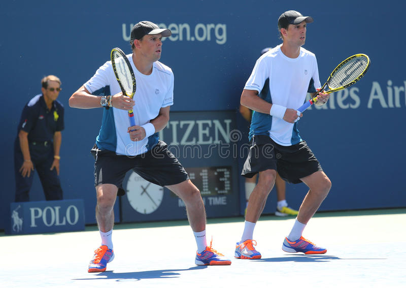 Grand Slam champions Mike and Bob Bryan during US Open 2014 semifinal doubles match. NEW YORK -SEPTEMBER 4, 2014: Grand Slam champions Mike and Bob Bryan during stock image