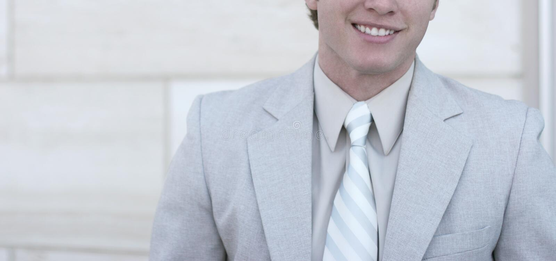Grand sourire sur l'homme d'affaires photos stock