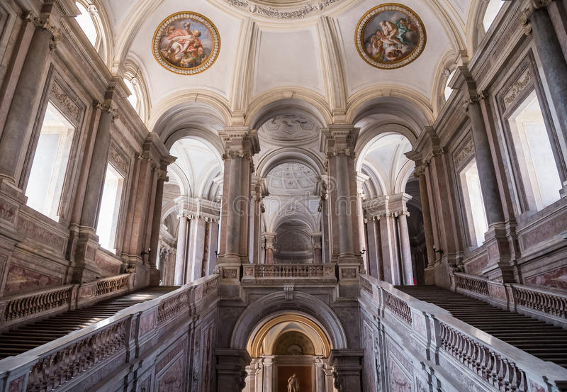 Grand Staircase of Honour in Royal Palace, Caserta, Italy. Caserta, Italy - August 29, 2016: Grand Staircase of Honour in Royal Palace, a former royal residence stock photo