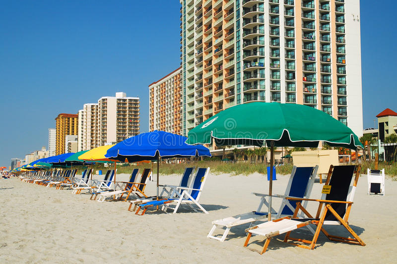 Grand Strand, Myrtle Beach SC. Umbrellas and chairs are set up for beach goers stock photo