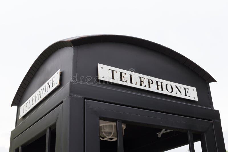 Grand téléphone payant noir de vintage photo libre de droits
