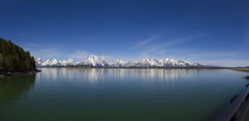 Grand Teton, Jackson Lake. Grand Teton`s Jackson Lake, Wyoming panorama in a sunny spring morning royalty free stock images