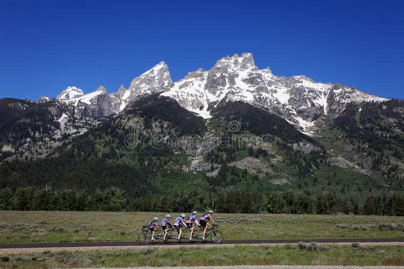 Riding a bicycle under the Grand Teton National Park stock images