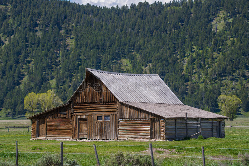 Grand tetons moulton barn mountain landscape old west ghost town. Historic landmark - the john multon homestead and barn located in the grand tetons national stock images