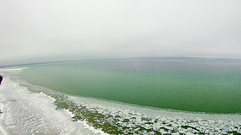 Grand traverse bay in state of michigan froszen in march stock photo