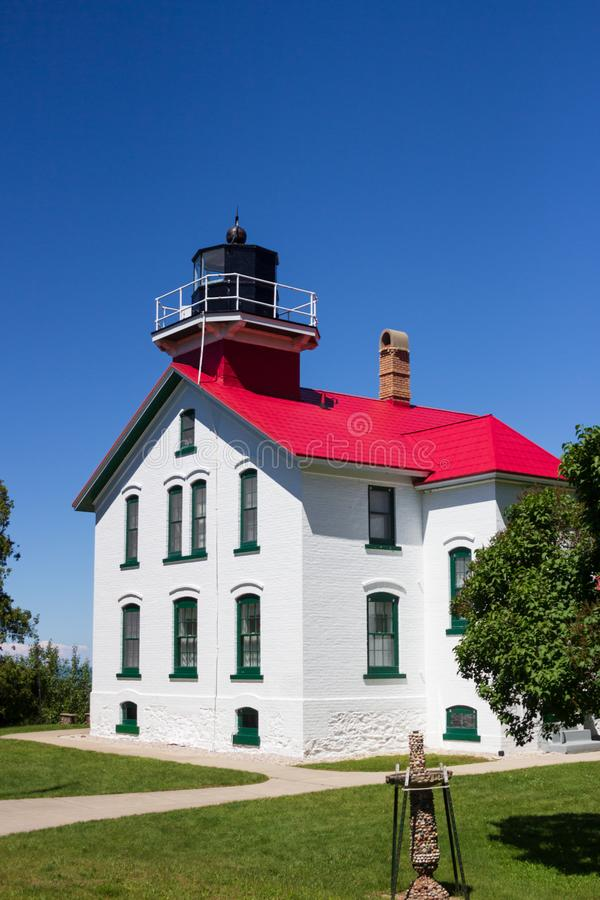 Grand Traverse Lighthouse Once Guided Mariners Safely Through Dangerous Waters. Become a lighthouse keeper for a week and stay in the Assistant Keeper`s Quarters royalty free stock images