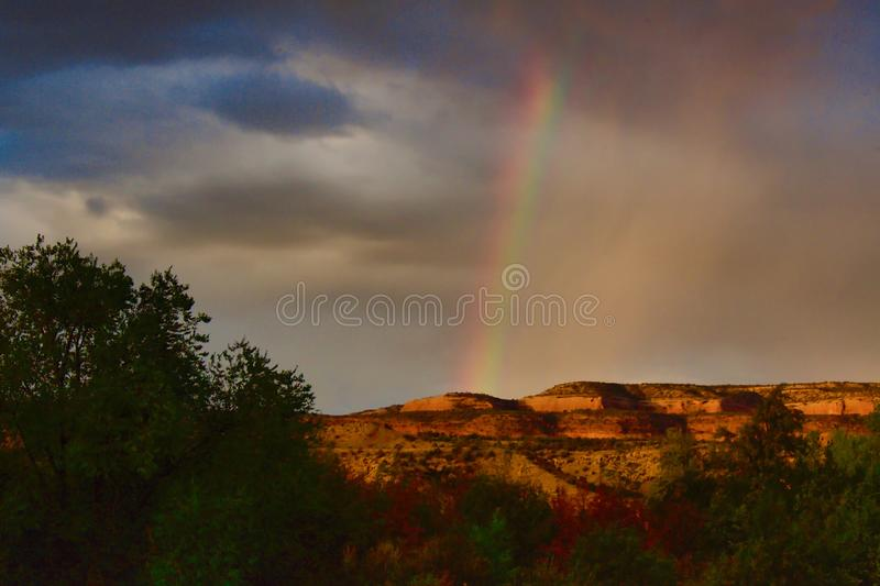 Grand Valley Sunrise Rainbow. The 2,000-plus acre Horsethief Canyon State Wildlife Area provides habitat for deer, coyotes, bobcat, doves, ducks, geese, quail stock image