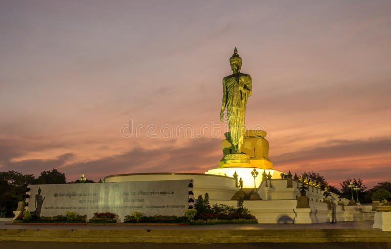 Grand Walking Buddha statue in Thailand royalty free stock images