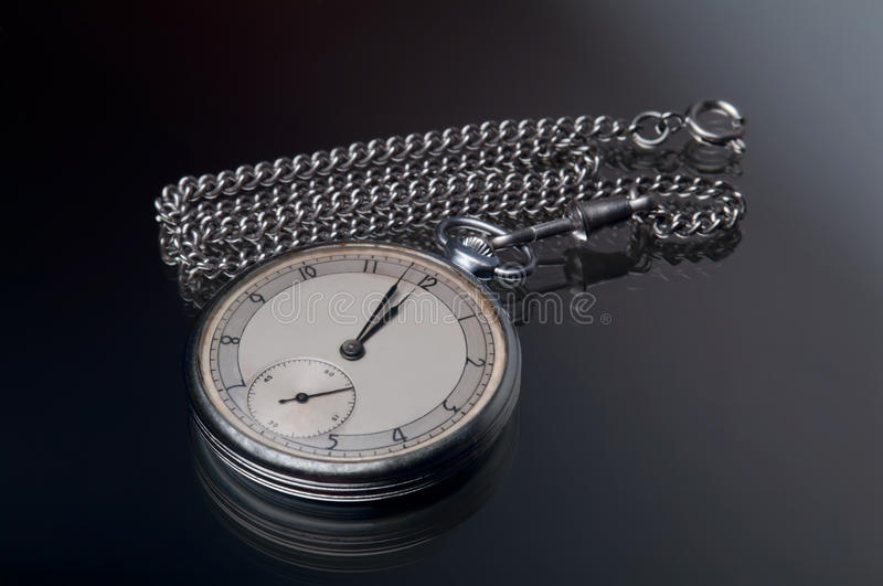 Grand watches. Old rusted pocket watches with watch-chain royalty free stock photography