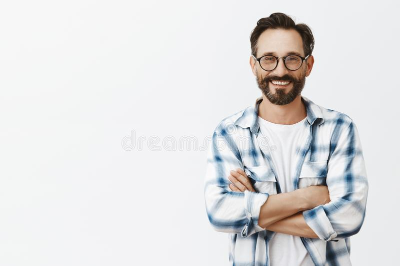 Grandads can be cool, look at me. Portrait of charming and carefree adult man with wrinkles and beard in glasses and royalty free stock photography
