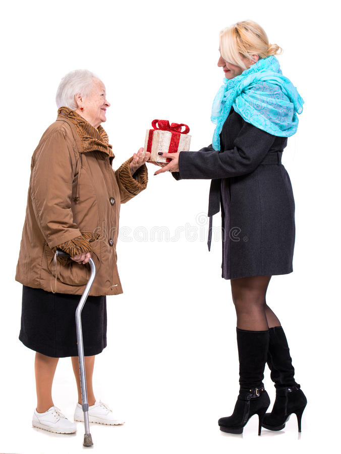 Download Grandaughter Giving Gift To Her Grandmother Stock Photo - Image: 35319702