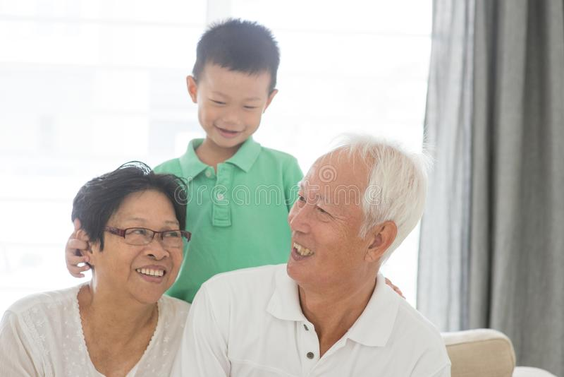Grandchild and grandparents royalty free stock images