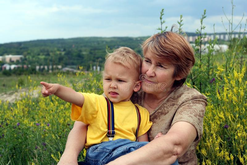 Download Grandchild Points By Finger To Grandmother Stock Photo - Image: 22178500
