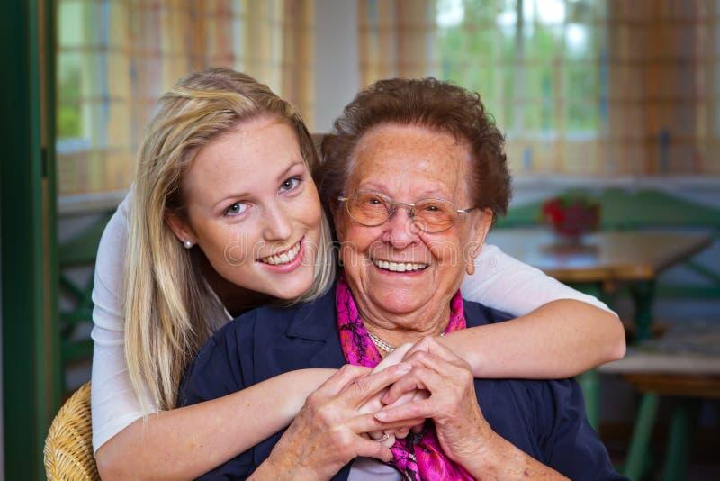 Grandchild Visits Grandmother Stock Images