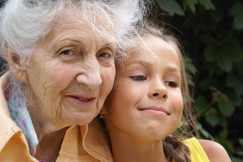 Granddaughter and her grandmother. Talking stock photos