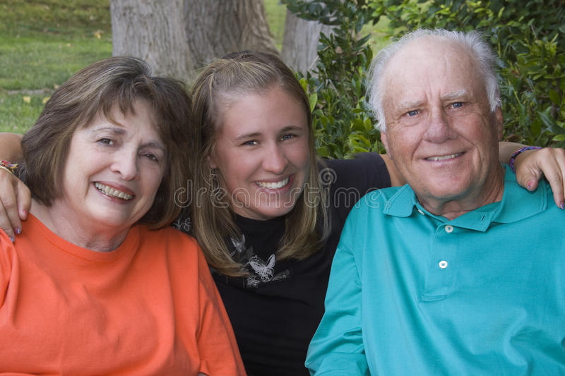 Granddaughter And Her Grandparents Stock Image
