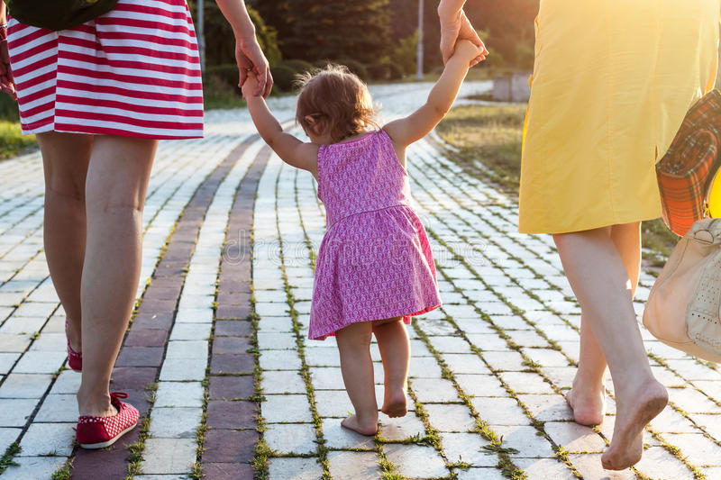 Granddaughter holding hands of mother and grandmother royalty free stock photo