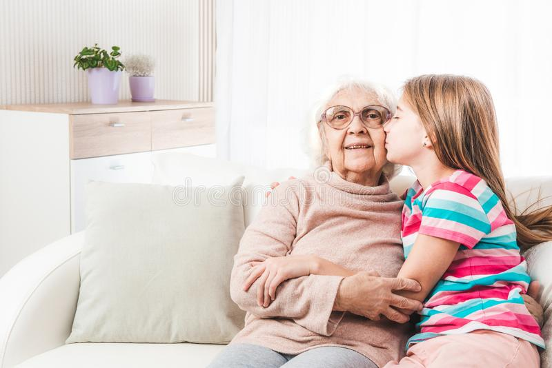Granddaughter lovely hugging grandmother stock photos