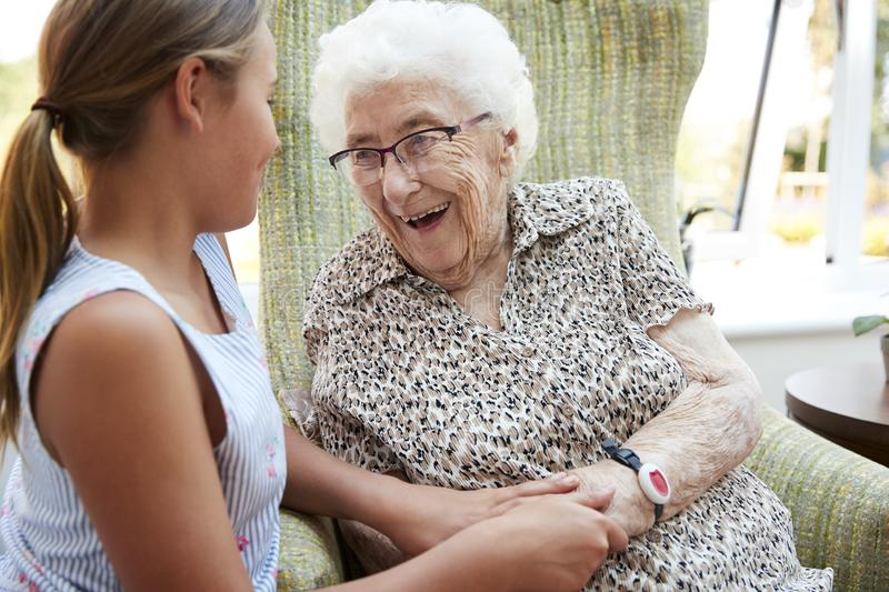 Granddaughter Visiting Grandmother In Lounge Of Retirement Home stock photo
