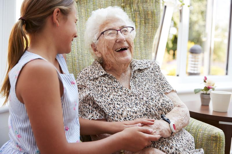 Granddaughter Visiting Grandmother In Lounge Of Retirement Home royalty free stock images