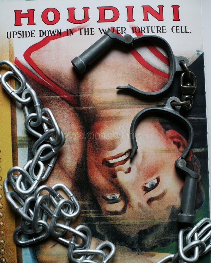Grande affiche de cellules de torture de Houdini avec des menottes et des chaînes photos stock