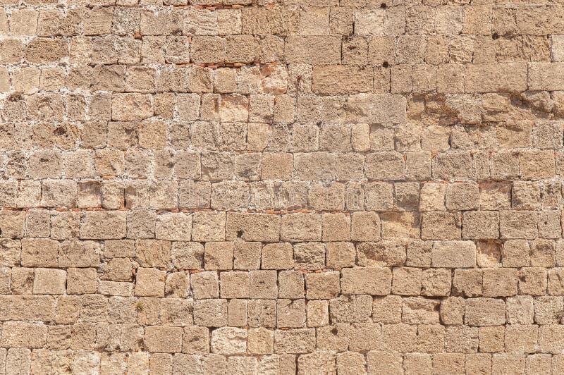 Grande architecture de mur de château de dommages de ciment de bloc de cube en roche de fond photos libres de droits