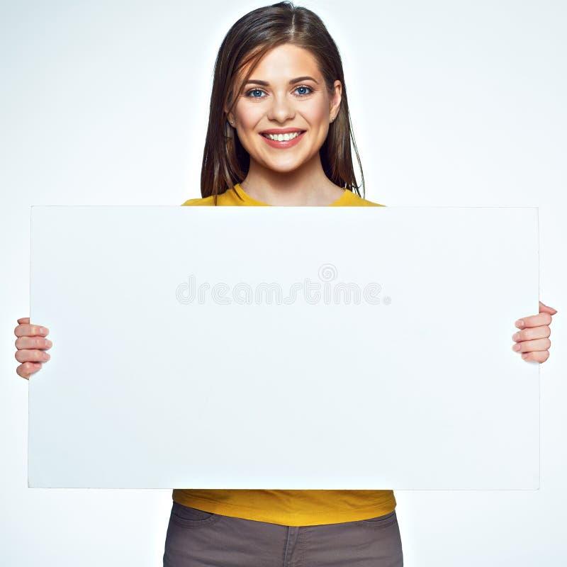 Grande bord del segno Ragazza sorridente che tiene insegna bianca fotografie stock