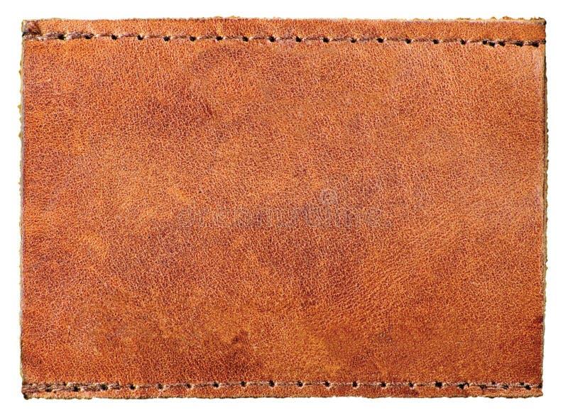 Grande distintivo vuoto, etichetta di cuoio granulosa naturale in bianco dei jeans dell'etichetta, fondo rustico di macro del mod immagini stock libere da diritti