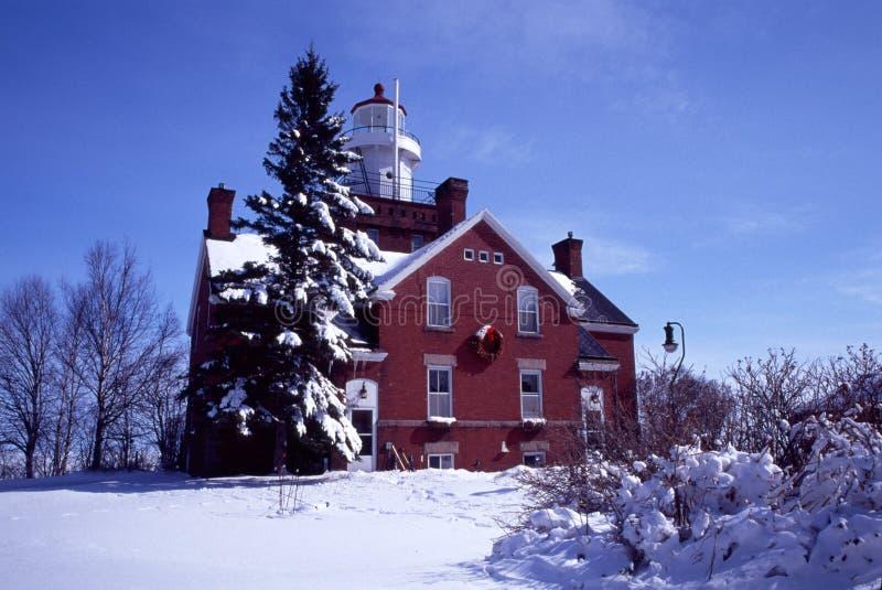 Grande faro Snowbound del punto della baia, MI fotografia stock