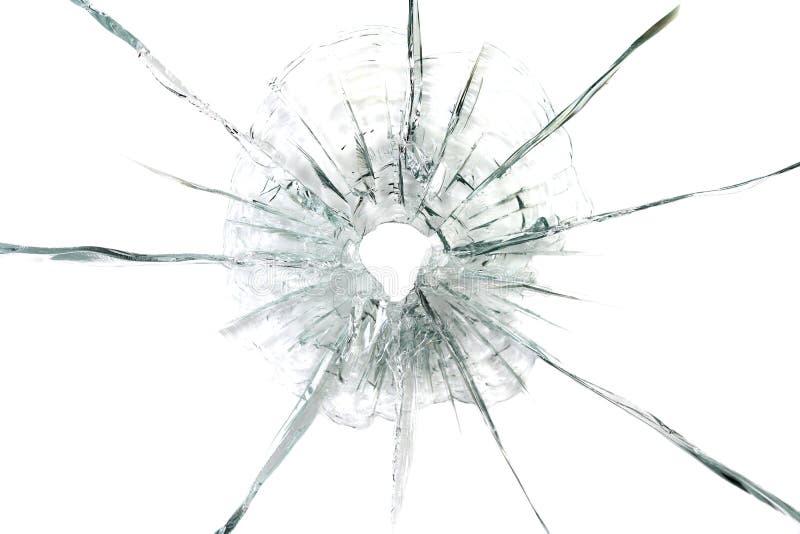 Grande foro di pallottola nel fondo di vetro fotografia stock libera da diritti
