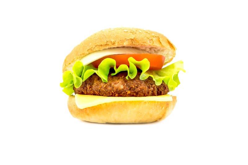 Grande hamburger con gli ortaggi freschi su un fondo bianco Foto luminosa fotografia stock
